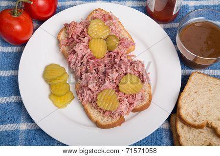 Sliced Pickles On Barbecue Pork Sandwich