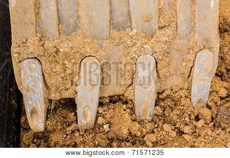 Excavator Digs A Hole In The Ground