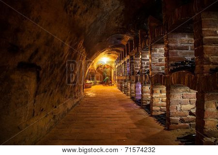 Long exposure of wine cellar with many kinds of wine bottles