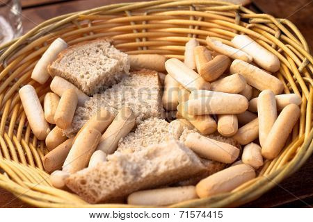 Basket With Bread And Bread Sticks