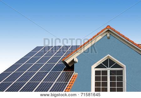 Modern New Built House, Rooftop With Solar Cells, Blue Front With Lattice Window