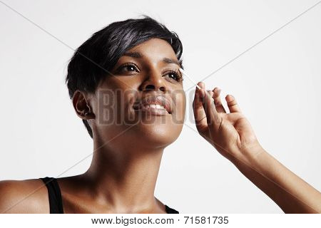 Beauty Black Woman With A Cotton Swab