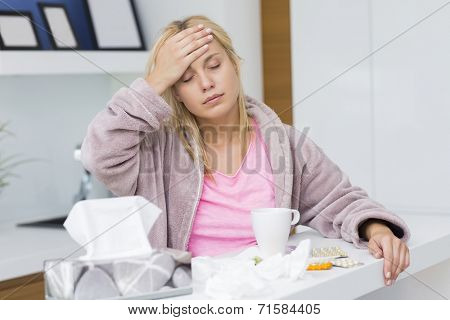 Young woman suffering from headache and cold