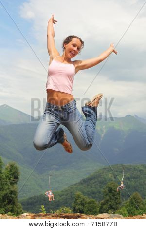 beautiful joyful woman is jumping.