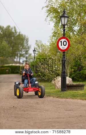 Boy Driving Buggy Cart