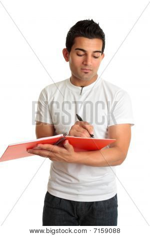 Man Or Student Writing In A Notebook