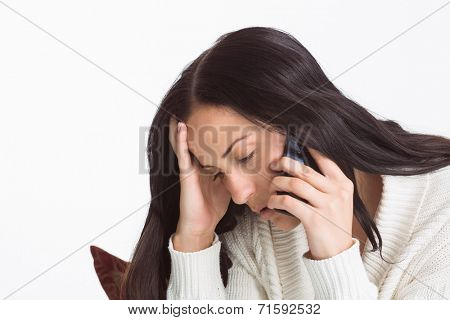 Woman suffering from a migrane on white background