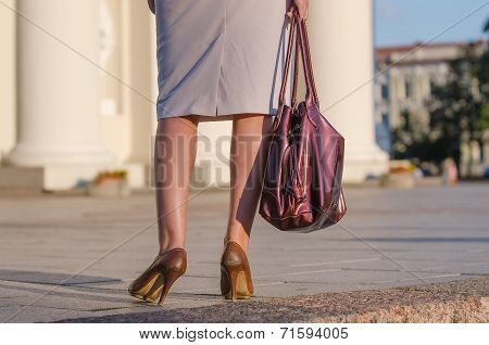 Legs of woman in the street