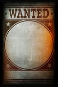 Picture of wanted poster printed on a grunge wall.