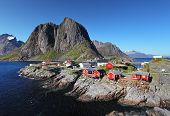 picture of reining  - Norwegian fishing village with traditional red rorbu huts Reine Lofoten Islands Norway - JPG