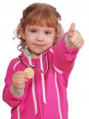 little girl with golden medal and thumb up