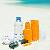 foto of deo  - water and sun protection cream on beach background - JPG