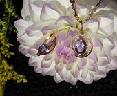pic of alexandrite  - Pendant and a ring with alexandrites against the backdrop of white - JPG