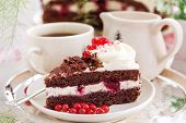 stock photo of black-cherry  - Piece of fresh homemade Black Forest cake with cherry and chocolate - JPG