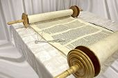 picture of torah  - the Torah the Jewish Bible laying on the table disclosed the combination of traditional Jewish law the five books of Moses the text