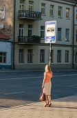 image of bus-shelter  - Young sexy woman waiting for the bus - JPG