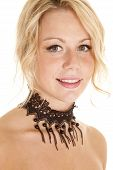 picture of chokers  - A woman looking with a smile wearing a choker with beads - JPG