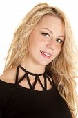picture of chokers  - A woman with a smile on her face wearing a black top with a black choker around her neck - JPG
