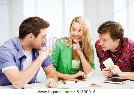 education concept - group of students gossiping at school