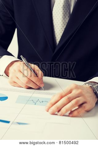 picture of businessman working and signing paper