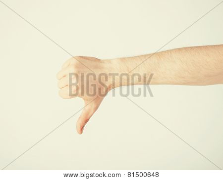 close up of man hand showing thumbs down