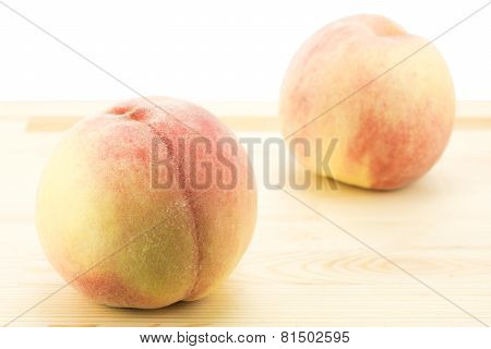 Peaches on wood board