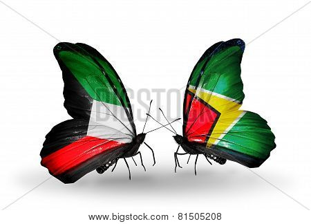 Two Butterflies With Flags On Wings As Symbol Of Relations Kuwait And Guyana
