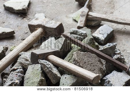 Concrete rubble debris with hammer