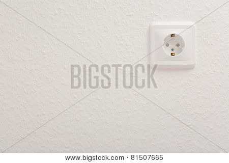 White Electric Socket At The Wall