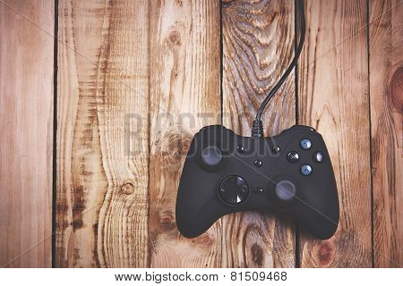 Joystick on a wooden background