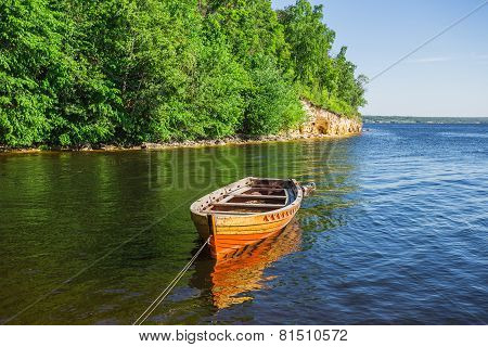 Wooden Boat On The River Bank