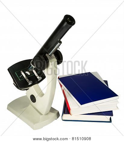 Microscope And Books Isolated On White