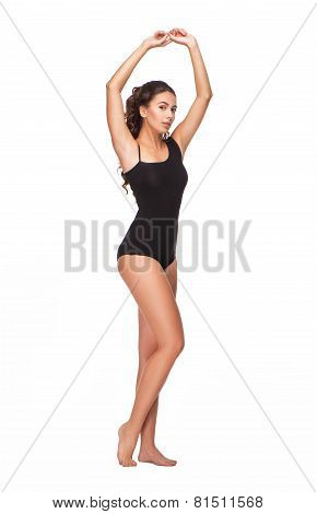 Stunning young woman with curly hair in black swimsuit