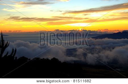 Maui sunset with misty clouds