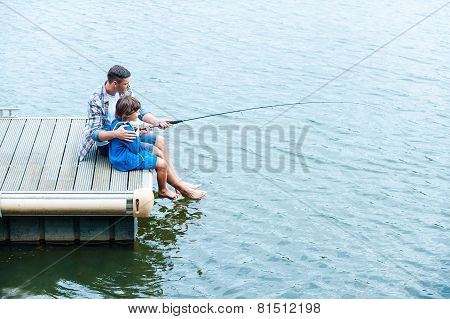 Father And Son Fishing.