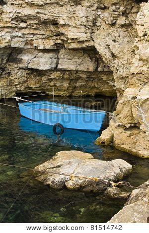 Boat In Rocks