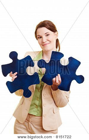 Businesswoman With Two Jigsaw Pieces