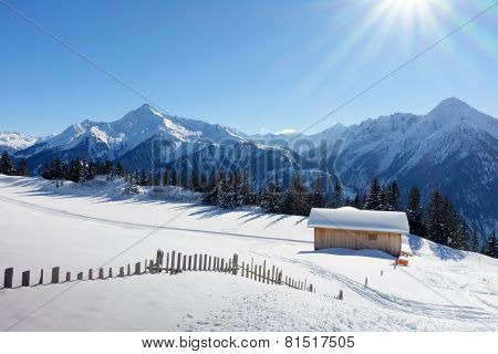 Ski lodge and cottage in the snowy Alps