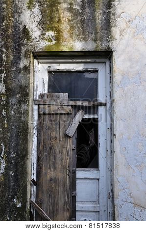 Old Door And Textured Wall