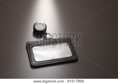 blank name tag holder on the gray background