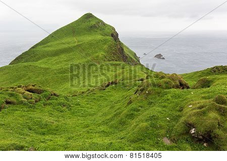 Green landscape on Faroe islands in summer.