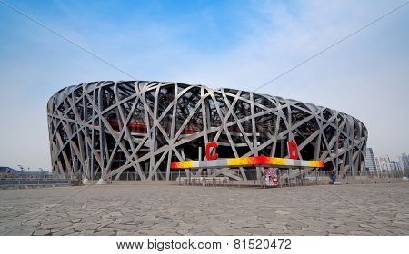 BEIJING, CHINA - APR 7: Beijing National Stadium with blue sky on April 7, 2013 in Beijing, China. The stadium was established for the 2008 Summer Olympics and Paralympics.