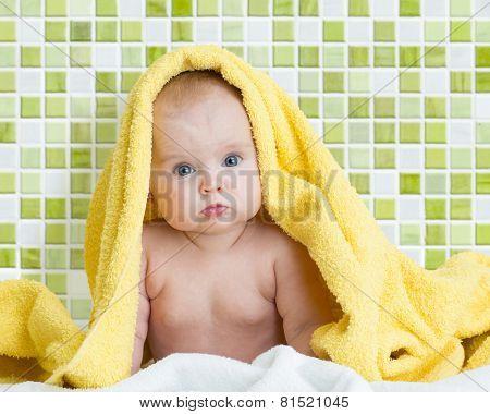 Cute baby in bathing towel