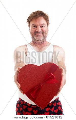 Scruffy middle aged man giving you a heart shaped box of candy for Valentines Day.  Isolated on white