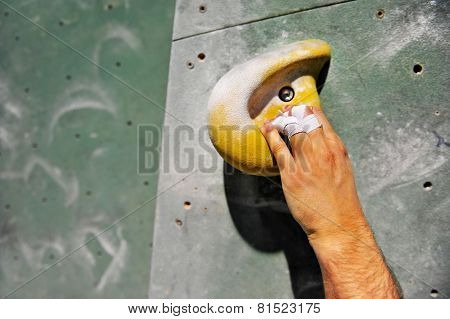 Hand On Artificial Climbing Wall