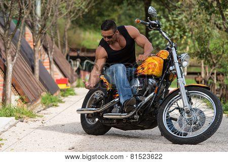 Biker In Sunglasses On The Road