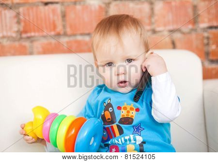 Little Boy Holding A Phone