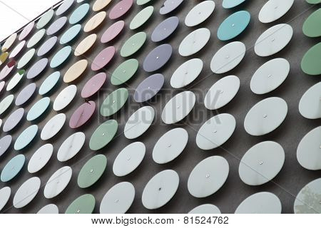 Modern Building Coated With Metallic Disc Pattern