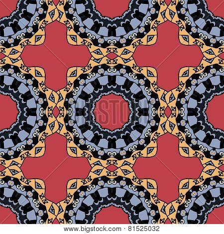 Seamless symmetrical pattern in red and yellow colors. Mandala. Kaleidoscopic motif.