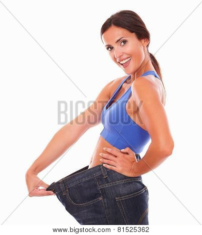 Fit Latin Woman Pulling Jeans On Waist